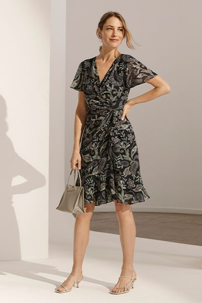 Woman in grey print dress