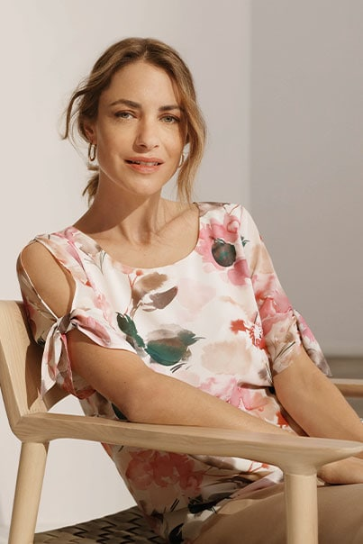 Woman in floral print blouse