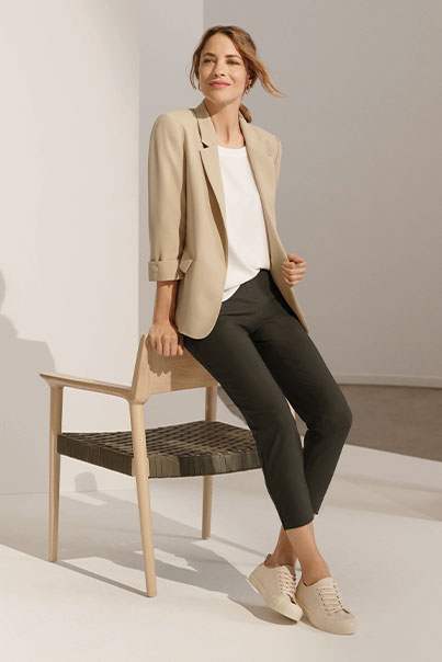 Woman in tan jacket