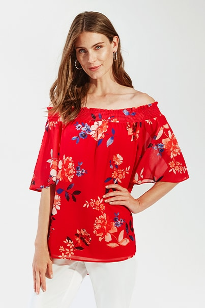 Woman in red floral print blouse
