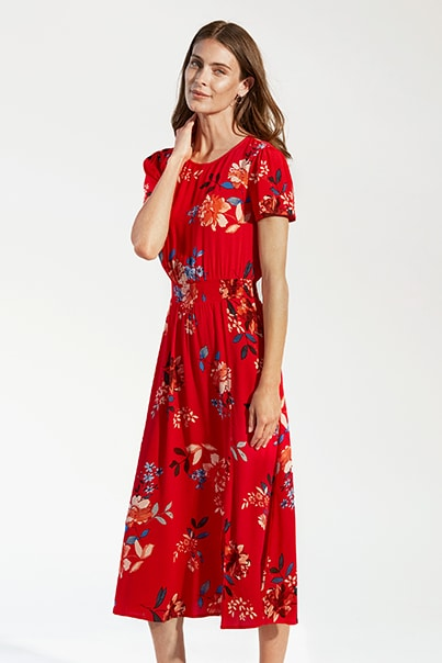 Woman in red floral print dress